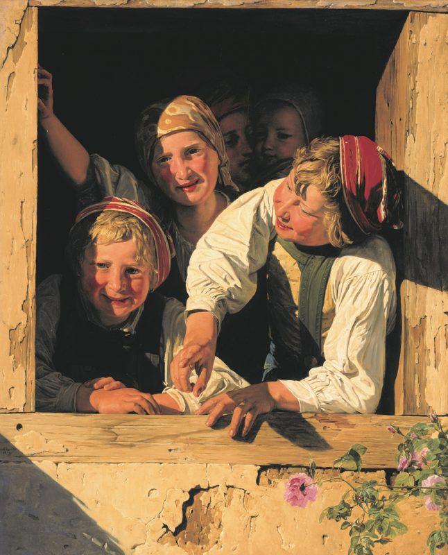 Fünf Kinder blicken aus einem Fenster.